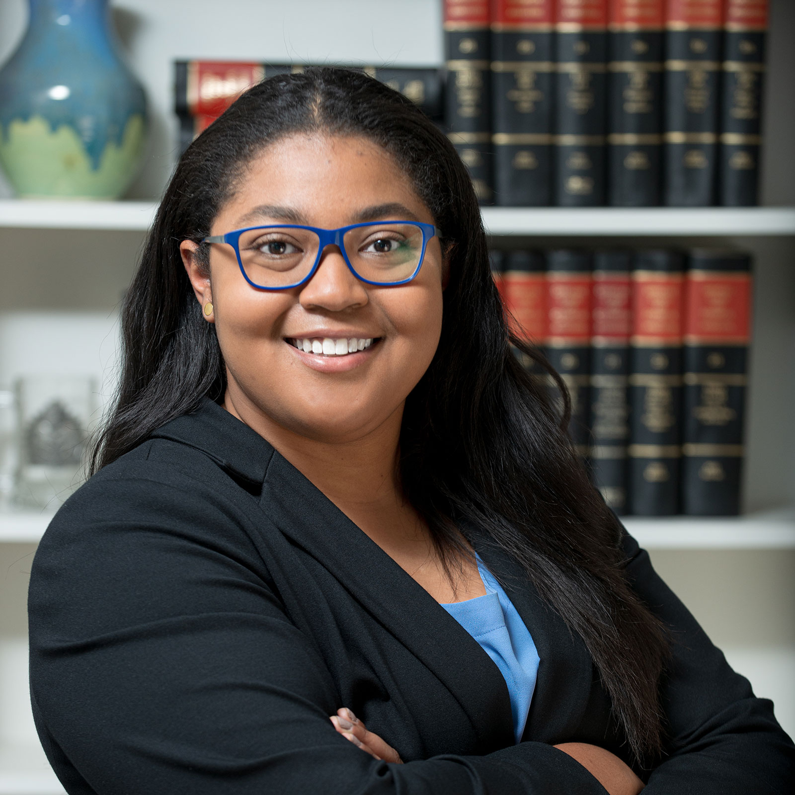Head shot of Caela Abrams, a business attorney serving Fulton County and Atlanta, Georgia.